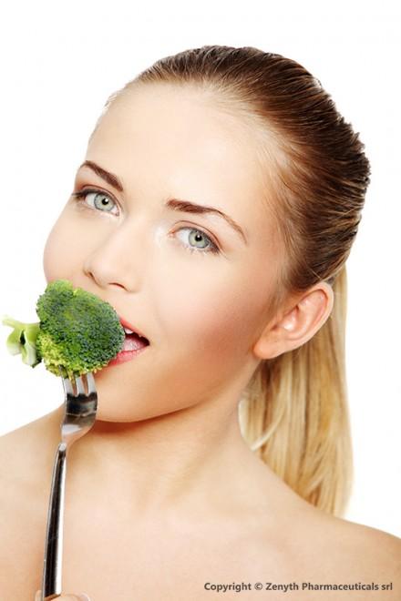 Woman eating green broccoli